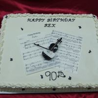 Sheet Music Full sheet cake with sheet music made from rice paper. Plastic violin.