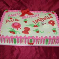 Strawberry Shortcake Meets Hello Kitty 9x13 iced in buttercream with fondant accents.