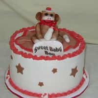 Sock Monkey This is a baby shower cake. I am happy with the way it came out. The monkey is fondant as are the other decorations.