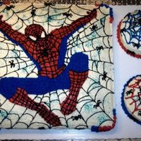 Spiderman all three cakes w/2 layer filling. 16-inch square...1/2 choc & 1/2 white, w/two 6-inch round cakes on the side. cream cheese frosting...