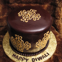 Diwali Cake Cake for India's celebration of lights Diwali. Choc. fondat with royal icing stencil and painted with gold luster dust.