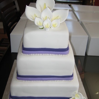 Cala Lily Square Wedding Cake Simple wedding cake.....I had to back 7 other sheet for the 400 person wedding.