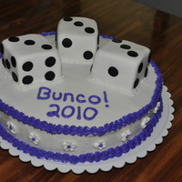 Bunco 2010! My MIL asked me to make a cake for her monthly Bunco game night so this was what I came up with. The dice are covered in fondant (DH helped...