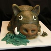 Hog Wild! DH got bit by a wild hog this winter(ripped shirt is in hog's mouth), so I used the story for inspiration for his birthday cake this...
