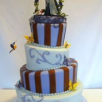 """the Corpse Bride"" Topsy Turvey Cake This unique topsy turvy wedding cake is themed after Tim Burtonâs The Corpse Bride. It has alternating tiers of white cake with..."