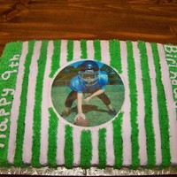 Football Field Cake edible image of football player. the rest covered in buttercream icing.