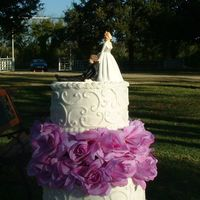Three Tier White Buttercream Wedding Cake This is my first Wedding Cake. This is a three tier white cake with snow white buttercream frosting. The cake design is small and medium...