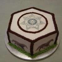 Posse Banquet Cake Edible image on top of cake, used stencil and spray food coloring to place the horses on each side (wish I had an airbrush!). Cake is...