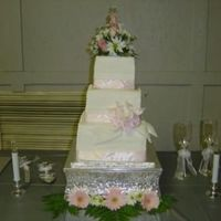 Jinnifer This is our first paid wedding cake! The bottom tier is double white chocolate chip, the second tier is german chocolate with buttered...