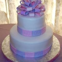 "Baby Shower -- Baby Feet 10"" chocolate hazelnut and 6"" coconut cream -- both covered in fondant with fondant accets. The bow is 50/50 gum paste and..."