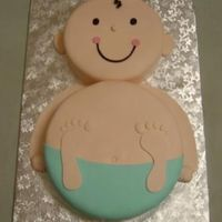 "Baby With Blue Diaper This is an 8"" and 10"" all fondant cake my sister and I did last night. Blue diaper was requested since the baby is a boy. This..."