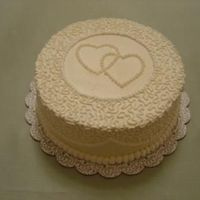Anniversary Cake White Chocolate Raspberry cake with White Chocolate frosting. You can't tell by the picture, but the main icing was ivory with white...