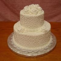 Sarah Requested all white cake with white roses. All buttercream. Sizes: 10-6. White cake with pineapple filling.