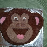 Monkey Cake This was the second cake done for my son's 3rd birthday. Banana cake and chocolate whipped frosting star tip#16 used. Cracker pan idea...