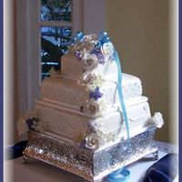 Zung's Touch Of Blue  This cake originally was to have separations filled with fresh flowers, but bride only gave us a handful of buds to work with. Thankfully...