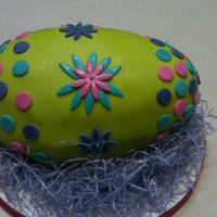 Easter Egg   lime green carved easter egg. The cake is gluten Free with a chocolate Ganache filling.