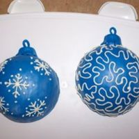 Christmas Ornaments These two mmf covered spice cakes were inspired by GRAMMASUE. It was my first attempt using the ball pan and making ornament cakes.