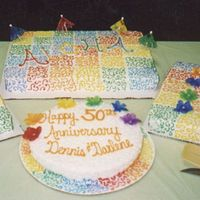 "Hawaiian Themed 50Th Anniversary Cake All buttercream. Side sheets cakes are 1/2 sheets (white, chocolate, marbled) and one 9"" cake (yellow). Comments appreciated."