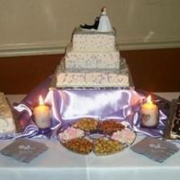 3 Tier Square Wedding Cake The 3 tier center cake is all white cake with white buttercream icing. The other cakes are yellow cake with chocolate frosting (bride...
