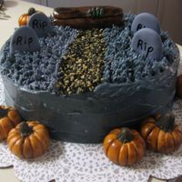 Graveyard Ok...Ok....its a little late but here is my halloween cake! Buttercream for the dead grass and the rest are gumpast figures. The walkway is...