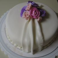 Pretty Simple  This was made for a coworker of mine...Fondent covered cake w/ buttercream and gumpaste flowers. The small pink ones were supposed to be...