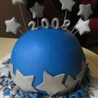 Happy Blue Year :) Made with fondant and LOTS of lusterdust. Yellow cake w/ vanilla filling.