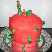 Apple For The Teacher Birthday Cake  I made this for DD's teacher. There is a worm for each student. Worms, stem/leaf made from fondant. Cake is buttercream with food...