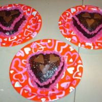 Mini Choc Hearts made these for my dd and her friends they are mini heart choc cakes with b/c filling and piping with choc ganache and tootsie roll hearts....
