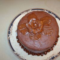 "Just For Practice  This is a 5"" vanilla cake with chocolate b/c cream frosting with mmf bottom boarder and a tootsie roll rose. Had fund doing this one I..."