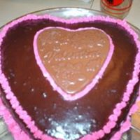 Valentines Day  choc cake/bc filling and piping ganache topping with choc valentines heart plaque. Made for dh for valentines day he said it was better...