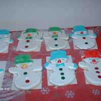 Snowmen On Parade I made these for DH to give to the guys as work instead of a xmas card. They love my sugar cookies so thought this would be a nice idea