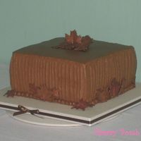 Fall Groom's Cake  I don't do many butter cream cakes and had to rush this one a bit. It is a chocolate cake with mocha butter cream. The smell was...