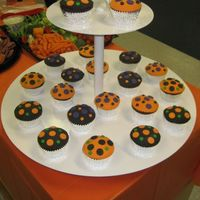 Halloween Dot Cakes   Cupcakes with fondant polka dots. I used a large biscut cutter to create the scolloped edges.
