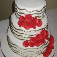 Red & Gold Wavy lines painted with gold luster dust and red gumpaste roses.