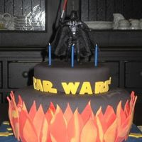 Star Wars  I really wish this cake came out a little cleaner. I dusted off the corn strach as best as I could. This was the first cake that I covered...
