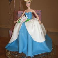 Cinderella Doll torso with fondant dress and decorations.