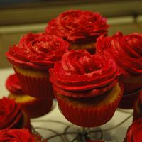 Vanilla Cupcakes With Red Buttercream Icing