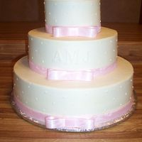 Mandy's Wedding This 6-10-14 wedding cake is covered with buttercream and accented with pink ribbon. The couples initials also accent the cake. This is a...