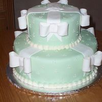 Green With Bows This is a findant covered cake accented with fondant/gumpaste bows.