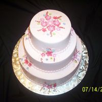 Kanitz Party This is a 6-9-12 buttercream creation with gumpaste flowers.