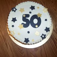 "50Th Birthday This is a 10"" round cake covered with buttercream. The black and gold decorations are made from fondant."