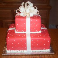 Red Boxes This fondant covered square tiered cake was made for a bridal shower. The bow is made from a fondant/gumpaste mix.