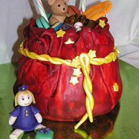 Santa's Bag Of Toys Gumpaste rope and stars. Everything else is fondant. This was a lot of fun to make! Thanks for looking! OK, just returned from the party,...