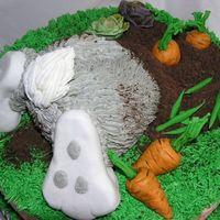 Bottom's Up! I took susanscakebabies great idea and added an Easter spin to it. Almond cake, orange marmelade filling. Veggies are gumpaste, feet are...