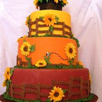 Sunflowers This is my entry for the county fair; design originally done by MadCakeMaker. Fondant, GP flowers and bee, 50/50 barrel, RI leaves and...