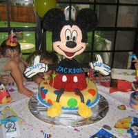 Mickey Mouse This was a BIG cake!!! Whole head is made of chocolate. Got idea from Wilton Book. The 2 year old LOVED it! The cake was as big as he was....