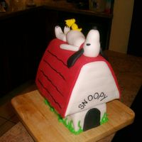 Snoopy Dog House Cake carved to resemble Snoopy's doghouse. Made for grandmother's 83rd birthday. All fondant accents. Snoopy laying on top of...