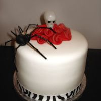Roses, Skulls & Spiders  Not really a Halloween cake, but I thought it would fit here best. Made for a friend who loves all things gothic. Cake is strrawberry cream...
