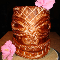 "Tiki Cake Cake was created using 4 stacked 6"" cakes. Covered in MMF and painted to look like wood. Flowers are gumpaste. Sand is brown and raw..."