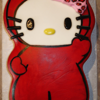 Hello Kitty Little Devil Cake was carved from a 1/4 sheet and covered in MMF and painted.
